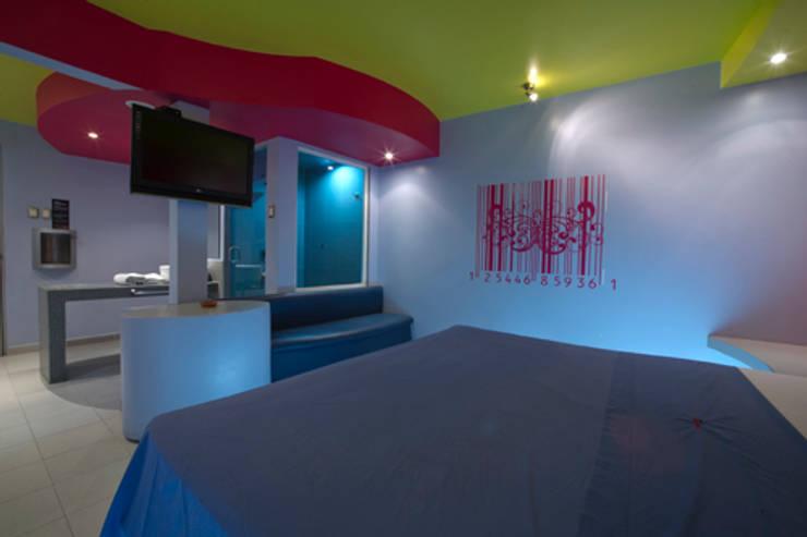 Hotel Condesa de Malibrán : Recámaras de estilo  por DIN Interiorismo