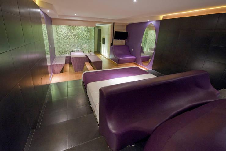 Hotel MaxIntimo : Recámaras de estilo  por DIN Interiorismo
