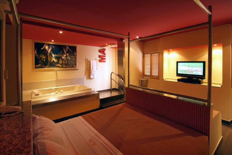 Hotel Metrópolis : Recámaras de estilo  por DIN Interiorismo