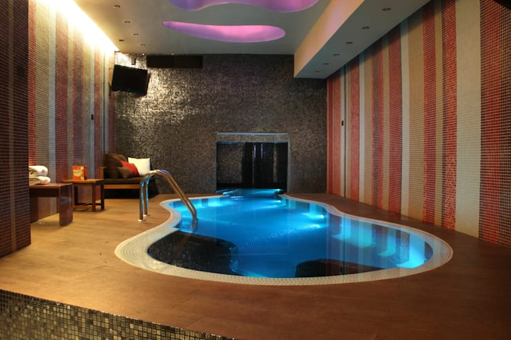Hotel Pirámides  Valle : Albercas de estilo  por DIN Interiorismo