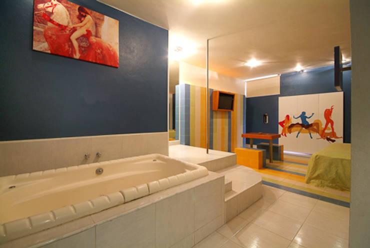 Hotel VC: Baños de estilo  por DIN Interiorismo