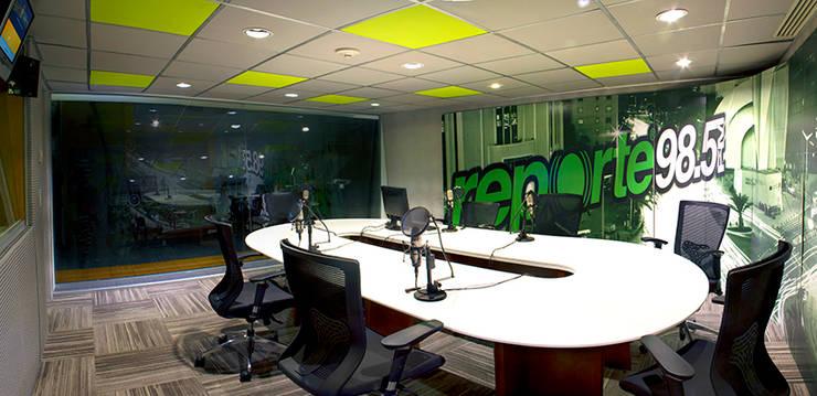Grupo Imagen : Estudios y oficinas de estilo  por DIN Interiorismo