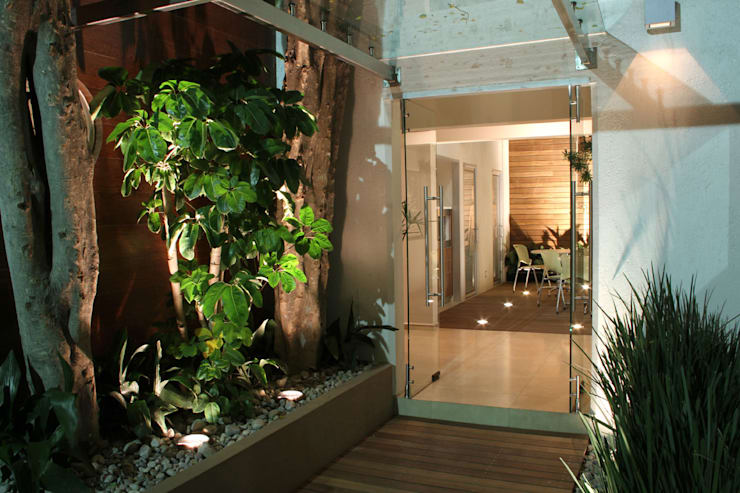 Houses by DIN Interiorismo ,