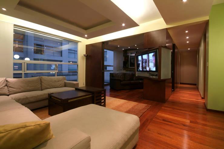Departamento Viniegra: Salas multimedia de estilo  por DIN Interiorismo
