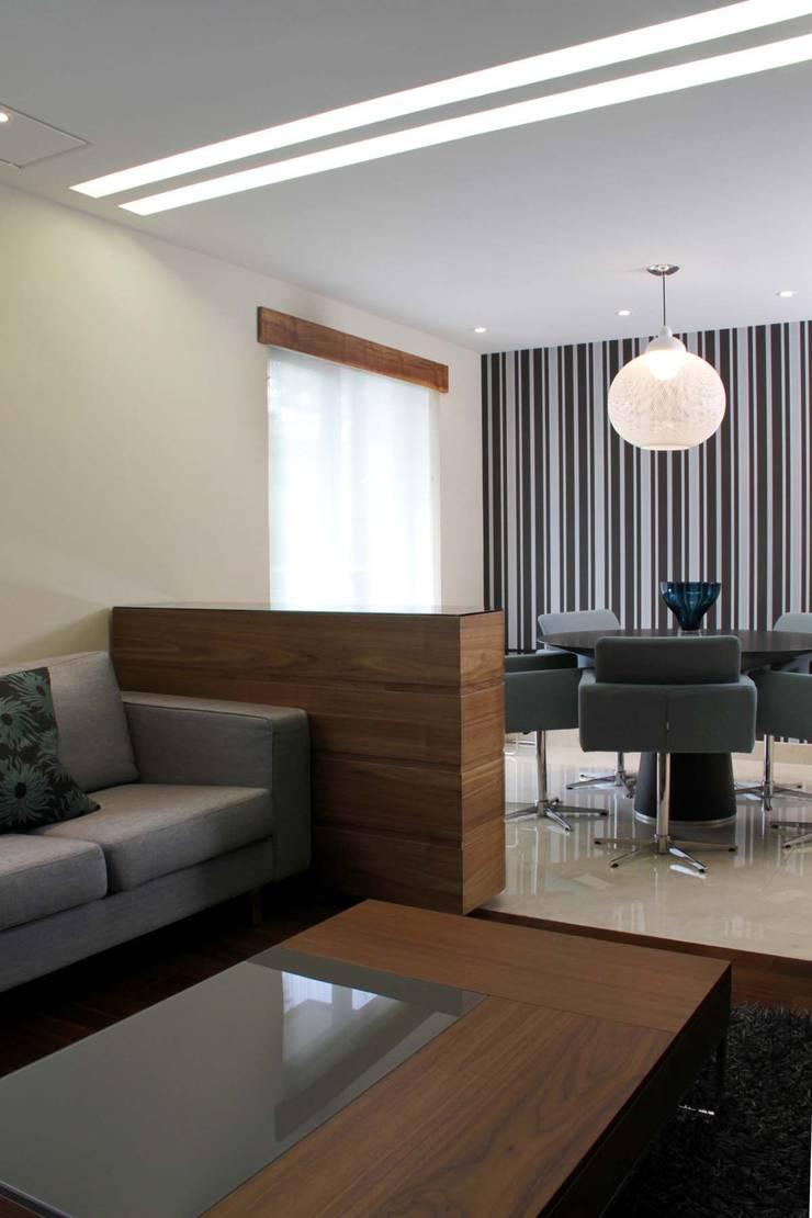 Departamento Jomap: Salas de estilo  por DIN Interiorismo