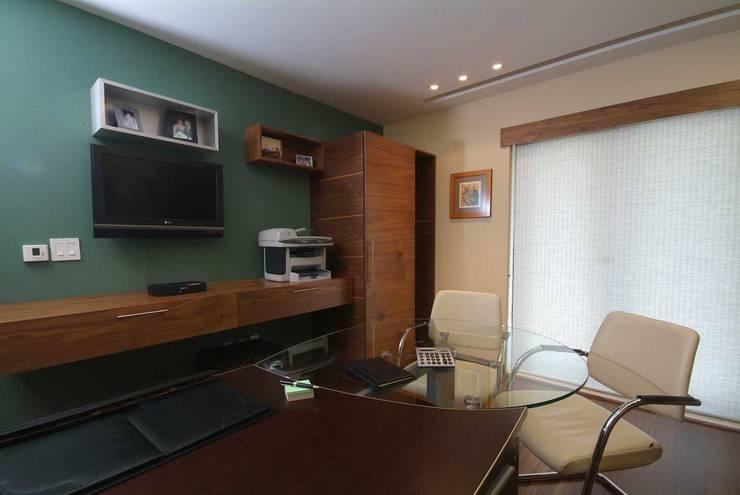Departamento Jomap: Estudios y oficinas de estilo  por DIN Interiorismo