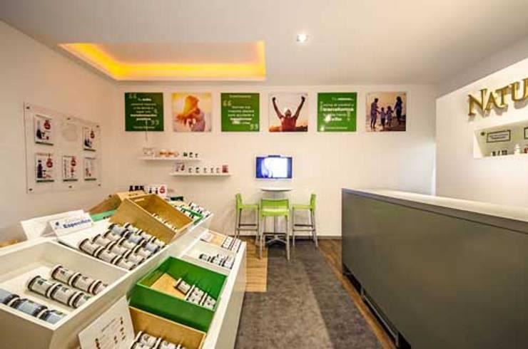 Nature´s Sunshine : Estudios y oficinas de estilo  por DIN Interiorismo