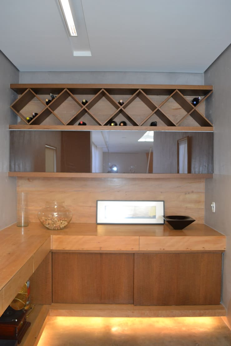Wine cellar by Juliana Goulart Arquitetura e Design de Interiores, Modern