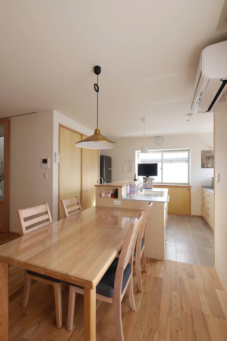 ペニンシュラキッチン: 池田デザイン室(一級建築士事務所)が手掛けたです。