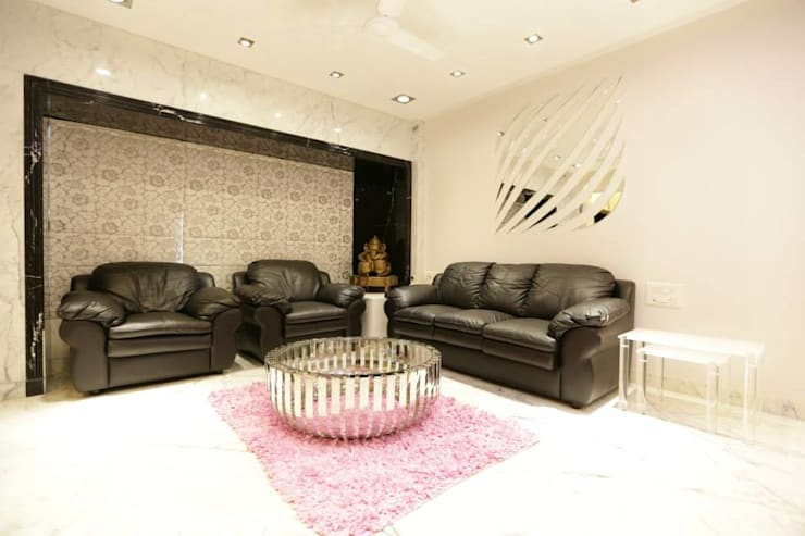 Interior Designs:  Living room by Ornate Consultants
