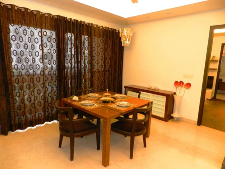 Interior designs:  Dining room by Allied Interiors