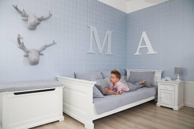 Łosie pikowane Cambridge: styl , w kategorii Pokój dziecięcy zaprojektowany przez Caramella
