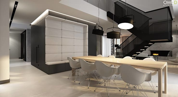 N.M. House: styl , w kategorii Jadalnia zaprojektowany przez OMCD Architects,Minimalistyczny