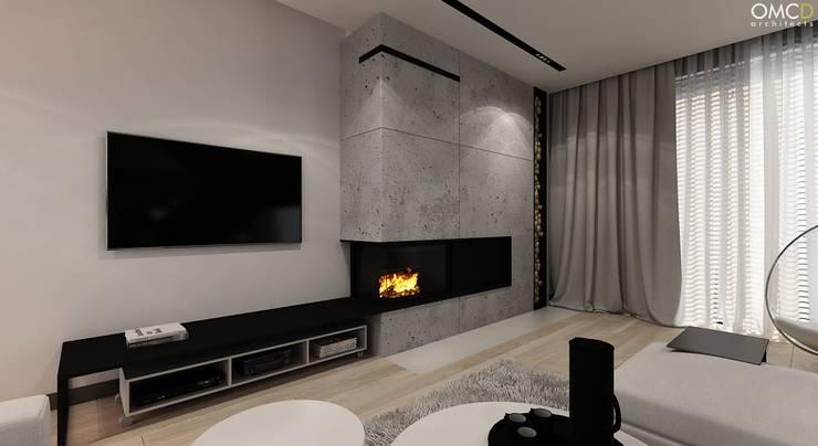 N.M. House: styl , w kategorii Salon zaprojektowany przez OMCD Architects,Minimalistyczny