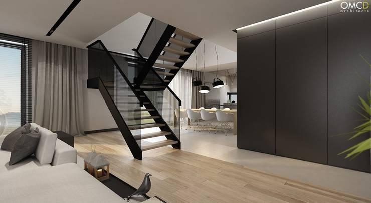 N.M. House: styl , w kategorii Salon zaprojektowany przez OMCD Architects