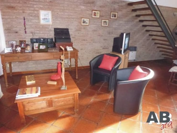 Interiores: Livings de estilo  por Arq. Alejandra Bruno,