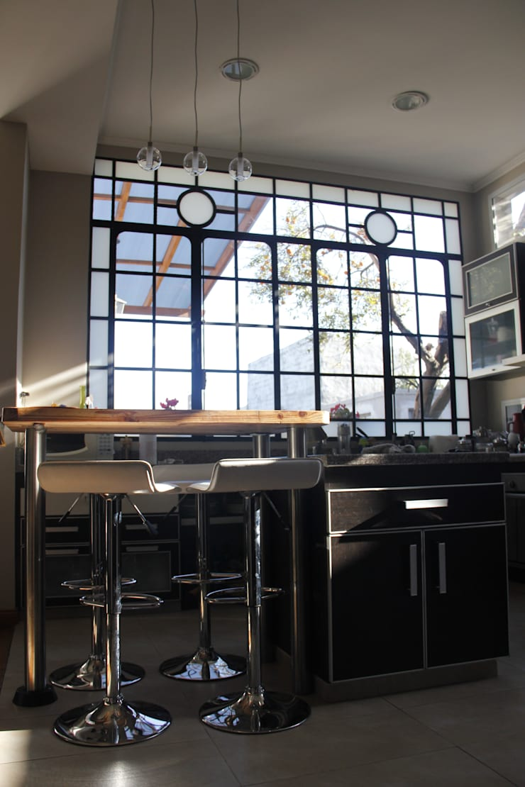 casa ciocastias: Cocinas de estilo  por laura zilinski arquitecta