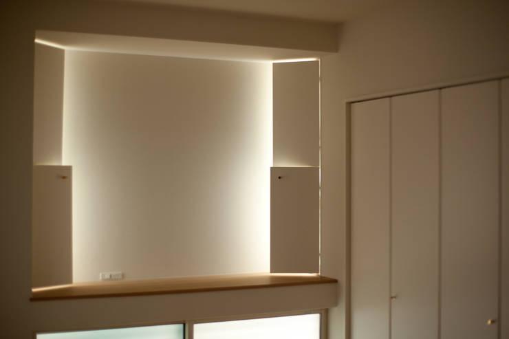 六十谷の家: 辻健二郎建築設計事務所が手掛けた寝室です。