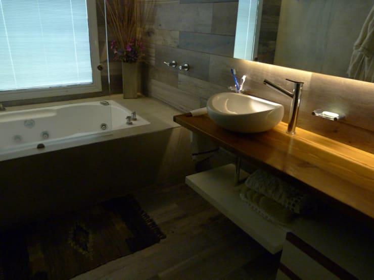 Baños de estilo  por DB muebles de diseño