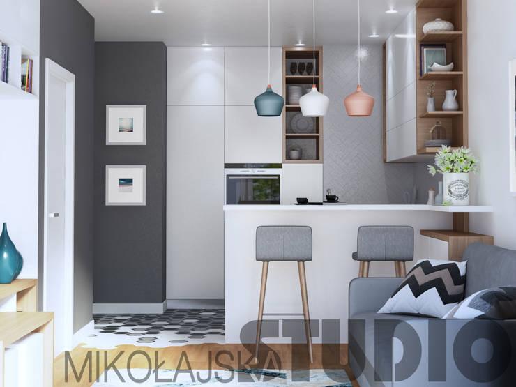 mieszkanie kompaktowe: styl , w kategorii  zaprojektowany przez MIKOŁAJSKAstudio