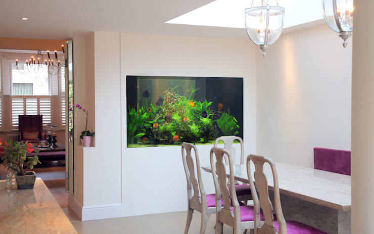 Dining room by Aquarium Architecture