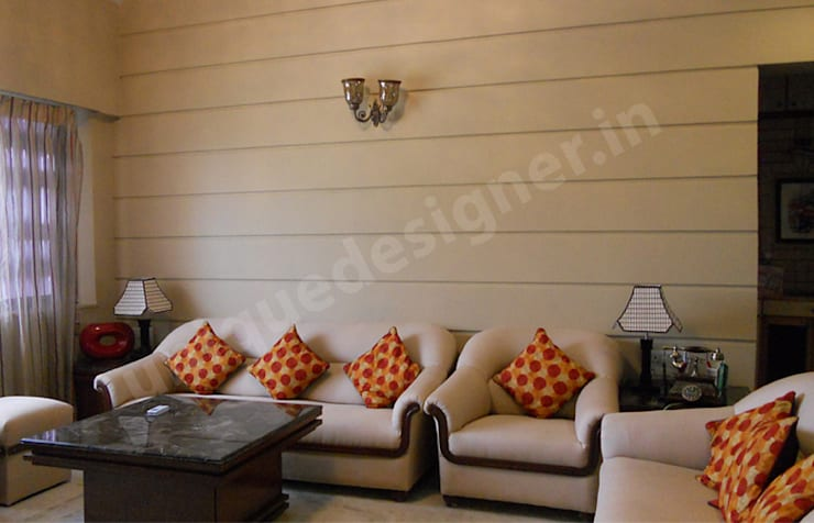Mr. Patkar:  Living room by UNIQUE DESIGNERS & ARCHITECTS,Modern