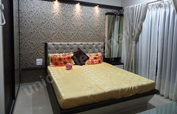Mr. Arjit Sarkar:  Bedroom by UNIQUE DESIGNERS & ARCHITECTS