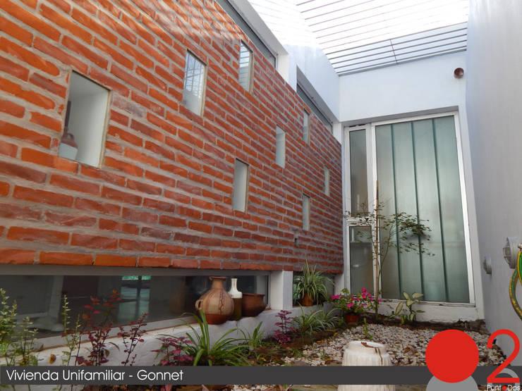 Jardines de estilo moderno por punto2