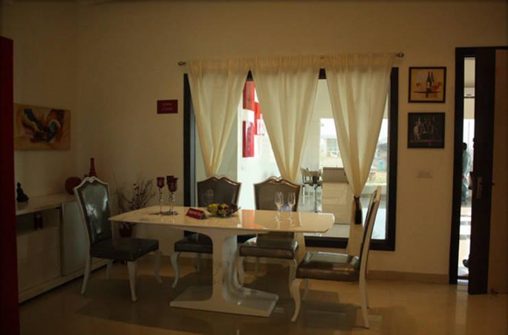 Dining Room Designs:  Dining room by ZED Associates Pvt. Ltd.,Modern