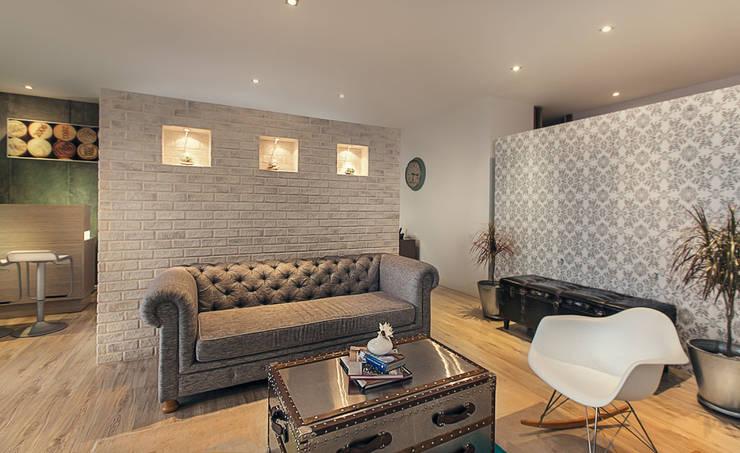 Sala auxiliar:  de estilo  por Cristina Cortés Diseño y Decoración , Moderno