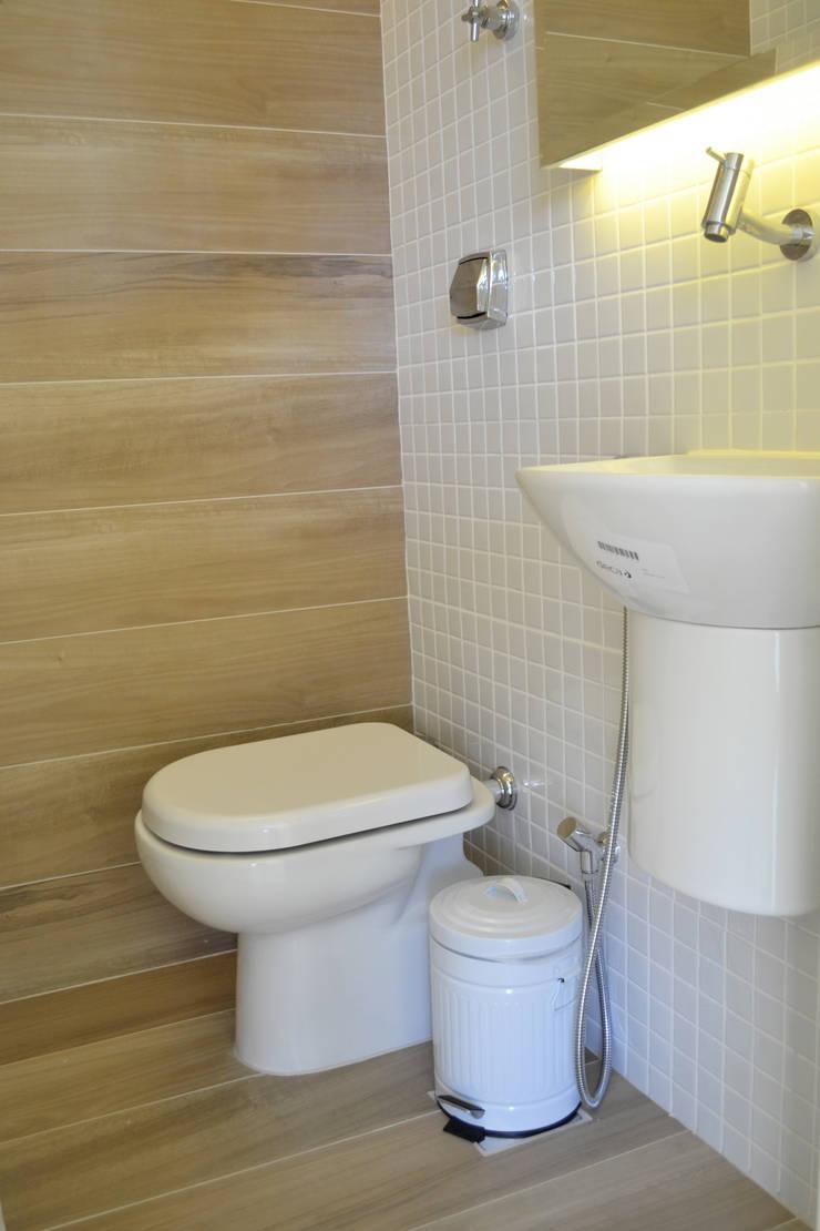 Cobertura RSB: Banheiros  por C|M Arquitetura e Design,