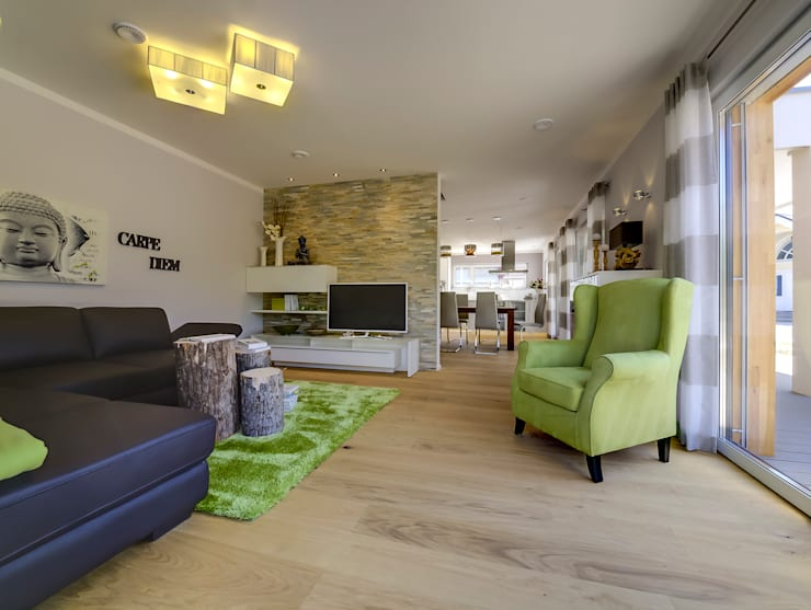 Ruang Keluarga by Licht-Design Skapetze GmbH & Co. KG