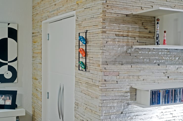 Parede de Pedra: Paredes  por Patrícia Azoni Arquitetura + Arte & Design