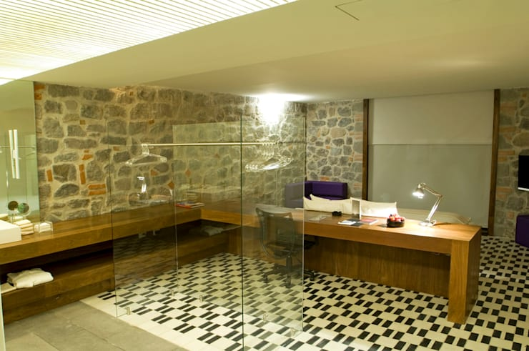 Baños de estilo  por Serrano Monjaraz Arquitectos