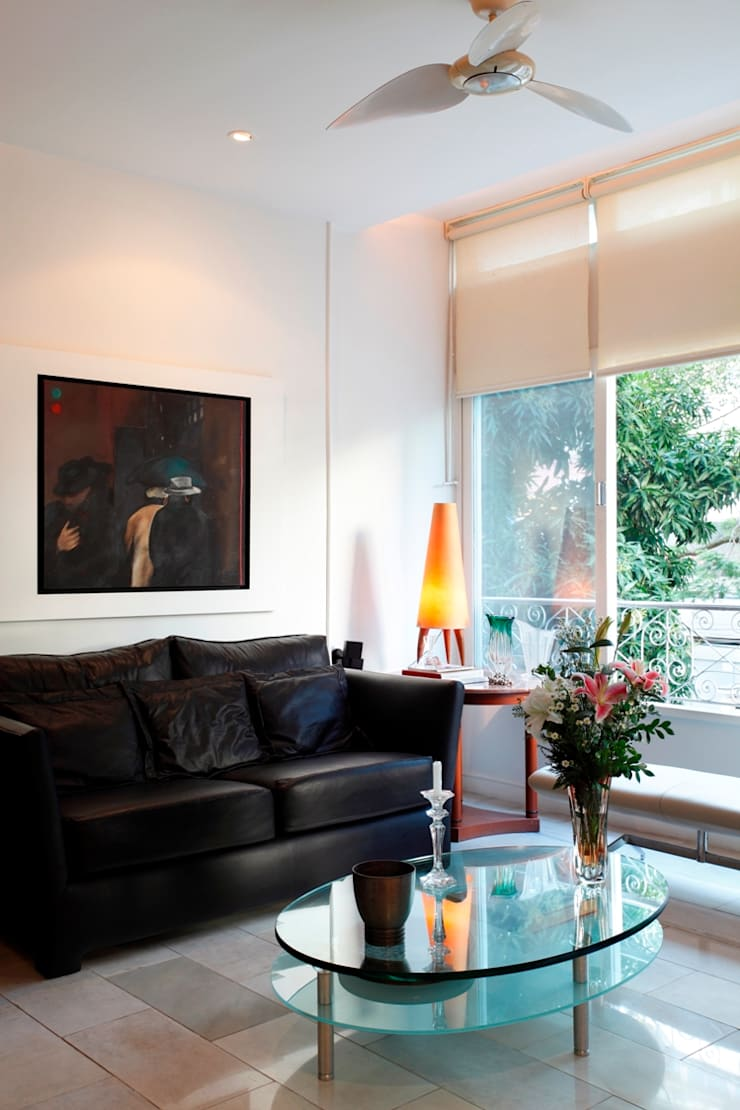 Apartamento Ipanema 3: Salas de estar  por Carlos Salles Arquitetura e Interiores,