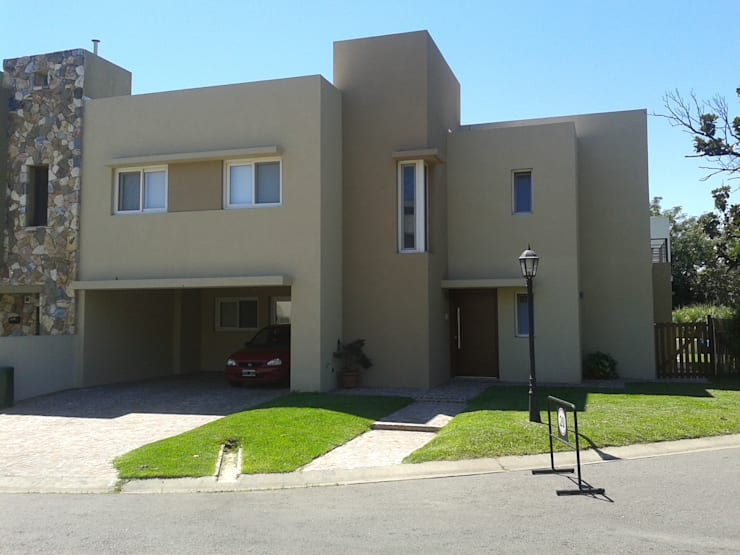 casa minimalista en San Isidro: Casas de estilo  por Family Houses