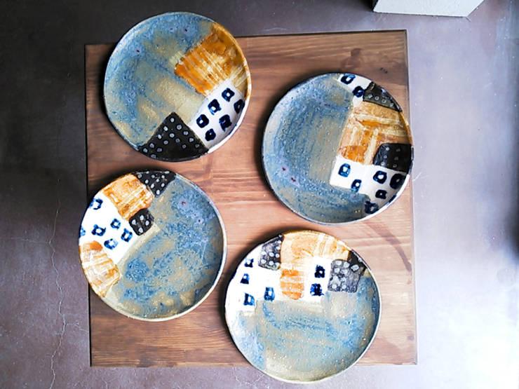 シリーズ『タウン』: 陶器食器店 a new sprout / junko sakamotoが手掛けたキッチンです。