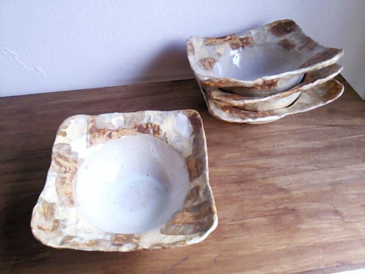シリーズ『白石畳』: 陶器食器店 a new sprout / junko sakamotoが手掛けたキッチンです。