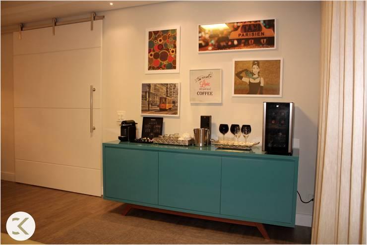 Projeto Auge Home Resort: Salas de estar  por Coppini & Khauam Arquitetura e Interiores