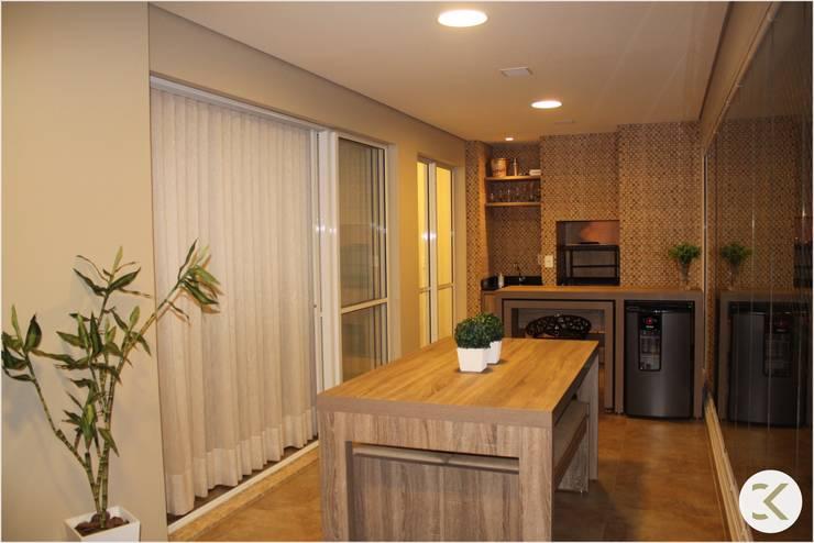 Projeto Auge Home Resort: Terraços  por Coppini & Khauam Arquitetura e Interiores,