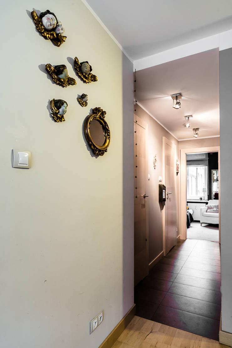 Mieszkanie w centrum miasta: styl , w kategorii Korytarz, przedpokój zaprojektowany przez Gzowska&Ossowska Pracownie Architektury Wnętrz