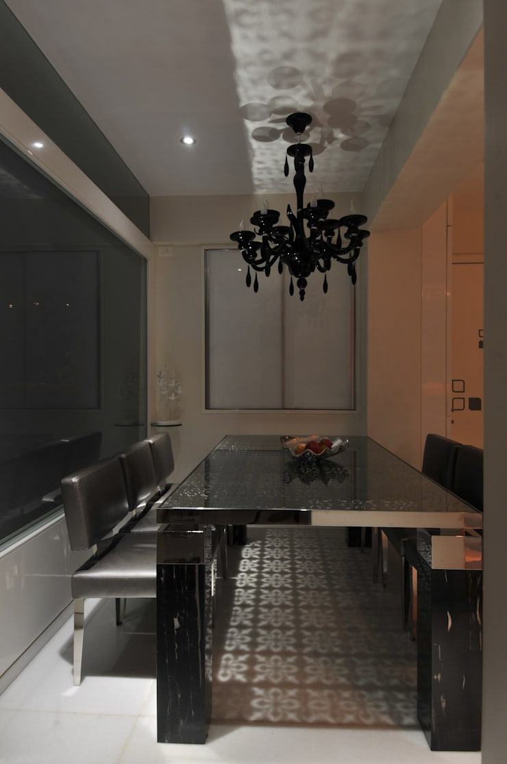 Site at Vile Parle :  Dining room by Mybeautifulife,Modern
