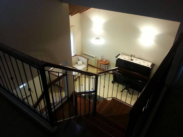 Excepcional casa : Salas de estilo  por Grupo Walls bienes raices
