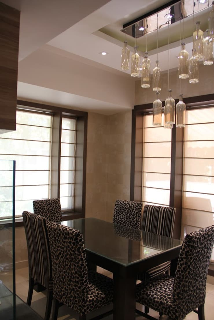 Chand Residence:  Dining room by Studio Ezube