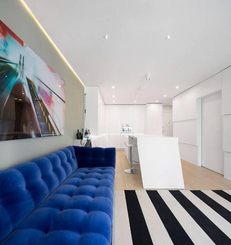 Apartamento Lisboa: Salas de estar  por Ana Maria Timóteo _ arquitecta