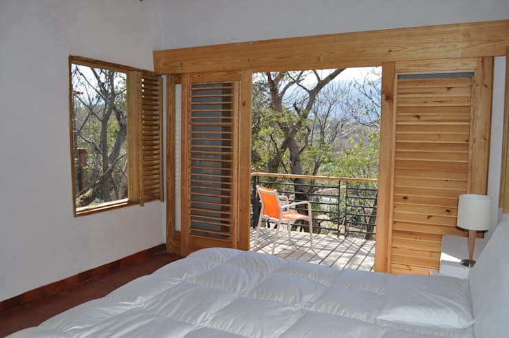 Casa de retiro Laguancha: Recámaras de estilo  por José Vigil Arquitectos