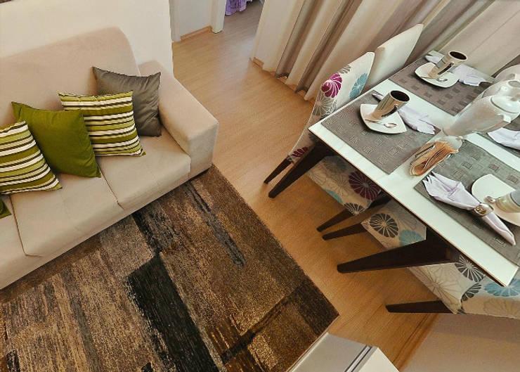 Apartamento decorado porto polaris: Sala de jantar  por Débora Campos Arquiteta,