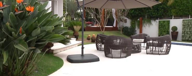 Residencial Tamboré II: Jardins  por RUTE STEDILE INTERIORES & ARQUITETOS ASSOCIADOS,