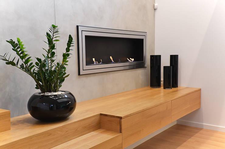 Minimalistyczne wnętrze domu w Janowie: styl , w kategorii Salon zaprojektowany przez Pracownia A