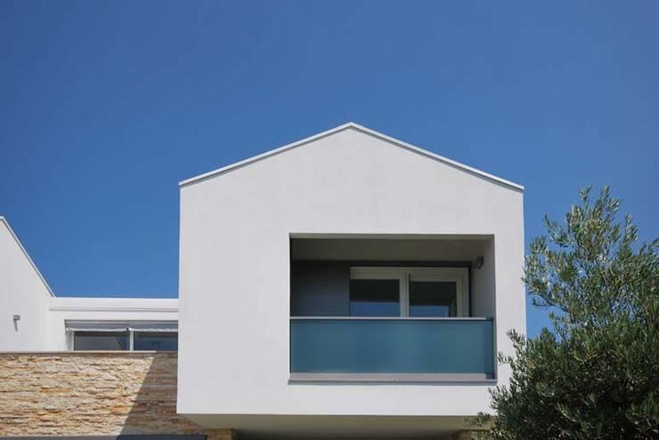 Casas de estilo  por STUDIO PIRACCINI